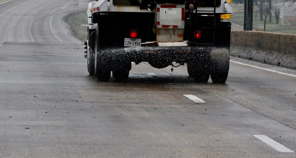 A TXDOT truck treats the southbound lanes Hwy. 67 over Camp Wisdom Road on February 28, 2019 in Dallas. Freezing temperature and wet conditions overnight led to icy roads, causing dozens of accidents.