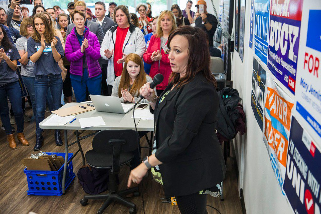 "Natalie Portman looks on as Mary Jennings ""MJ"" Hegar, then the Democratic nominee for Texas' 31st congressional district, spoke at her campaign office Thursday, Oct. 25, 2018, in Cedar Park."
