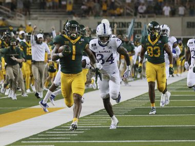 Baylor running back Trestan Ebner, left, scores past Kansas safety Nate Betts in the second half of an NCAA college football game, Saturday, Sept. 26, 2020, in Waco, Texas.