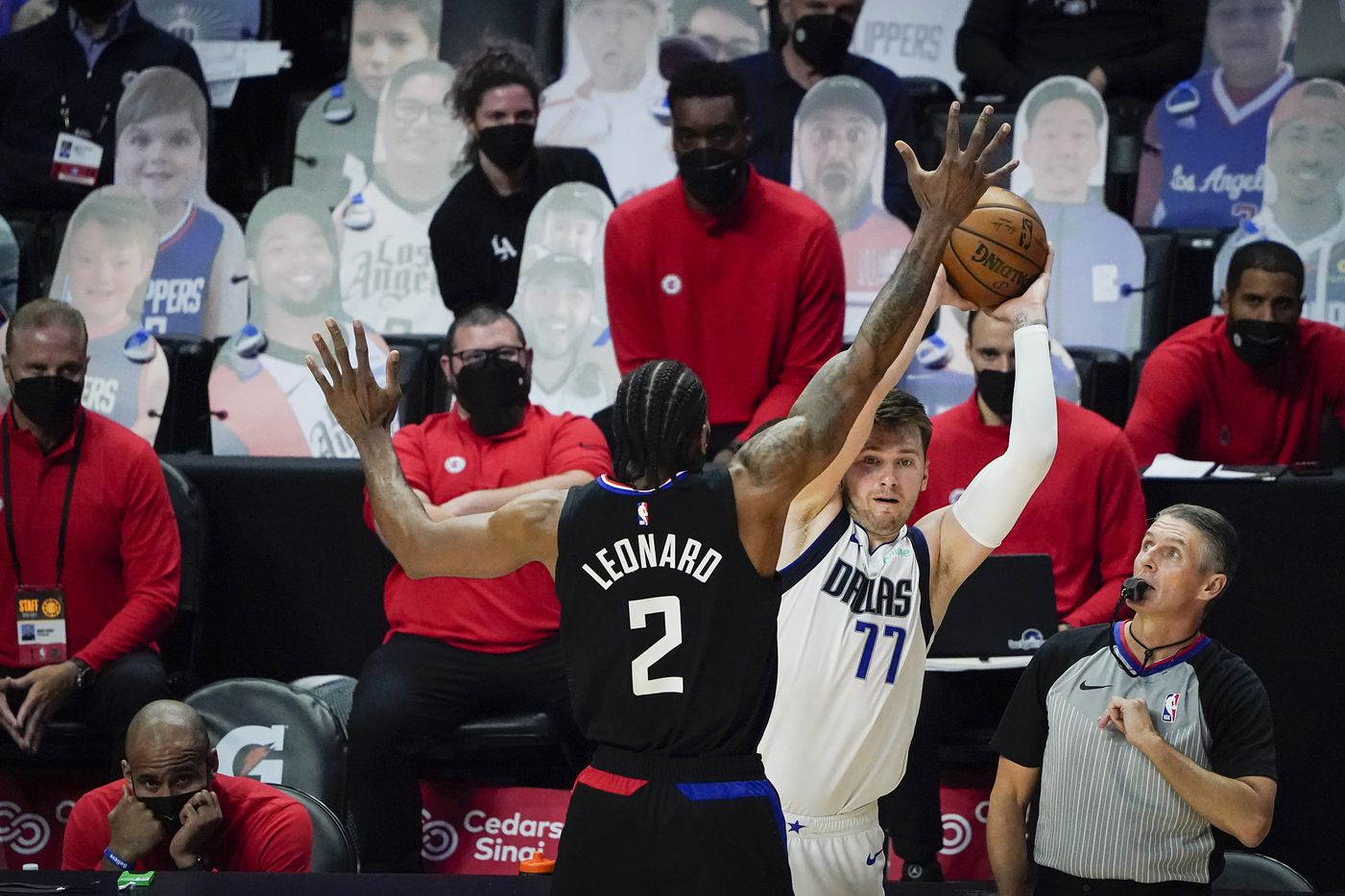 Dallas Mavericks guard Luka Doncic (77) inbounds the ball past LA Clippers forward Kawhi Leonard (2) during the second half of an NBA playoff basketball game at Staples Center on Wednesday, May 26, 2021, in Los Angeles. The Mavericks won the game 127-121.