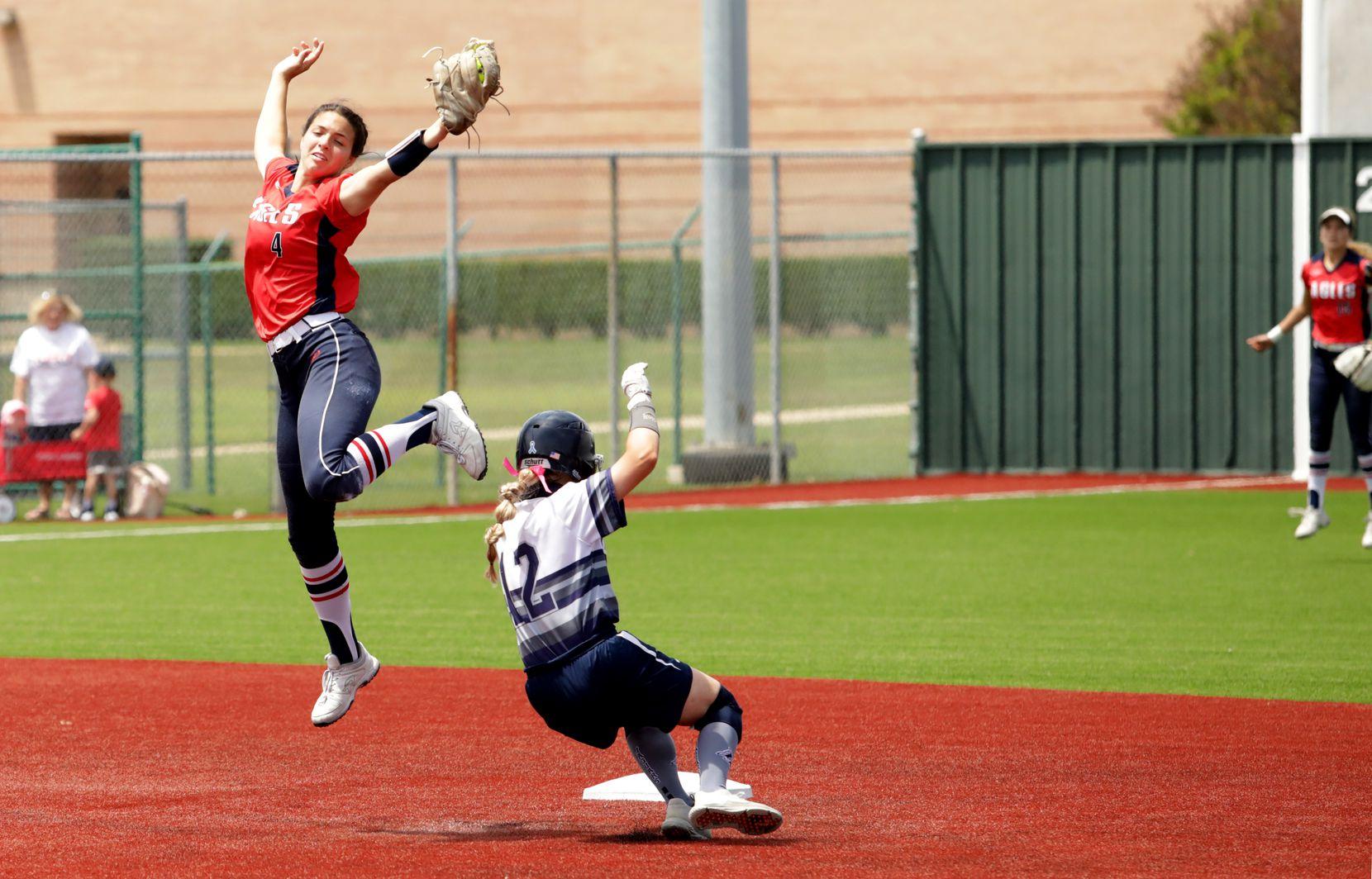 Allen High School player #4, Sami Hood, attempts to stop Flower Mound High School player #12, Jenna Becker, during a softball game at Allen High School in Allen, TX, on May 15, 2021. (Jason Janik/Special Contributor)