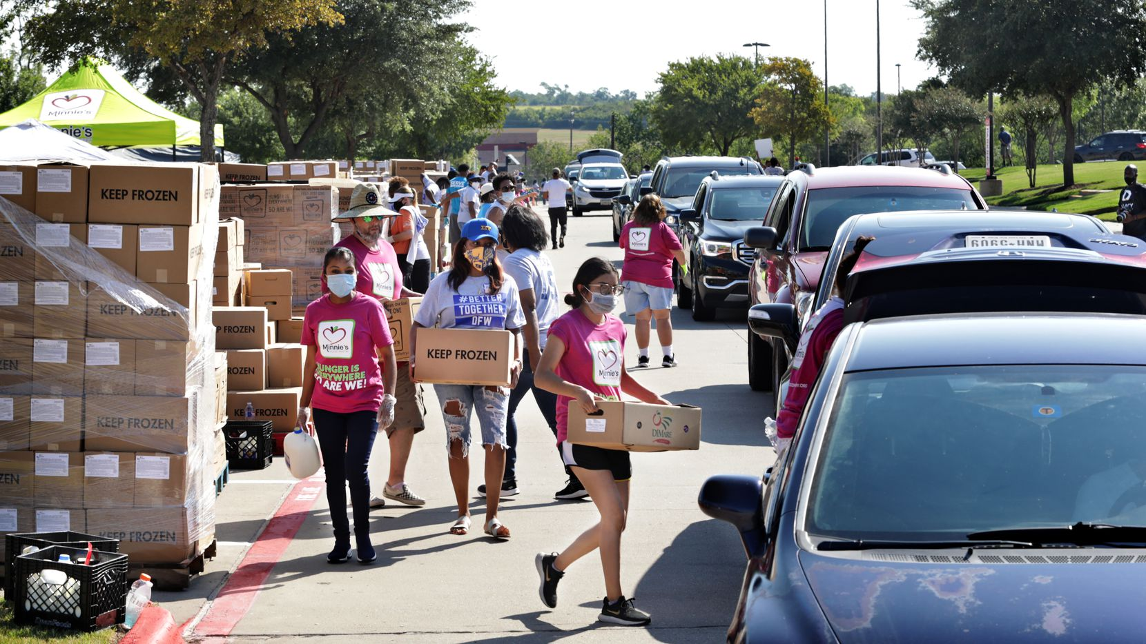 Volunteers with Minnie's Food Pantry distribute free food at One Community Church in Plano, TX, on Aug. 22, 2020. A similar food distribution will take place at at Lone Star Park in Grapevine this Friday.