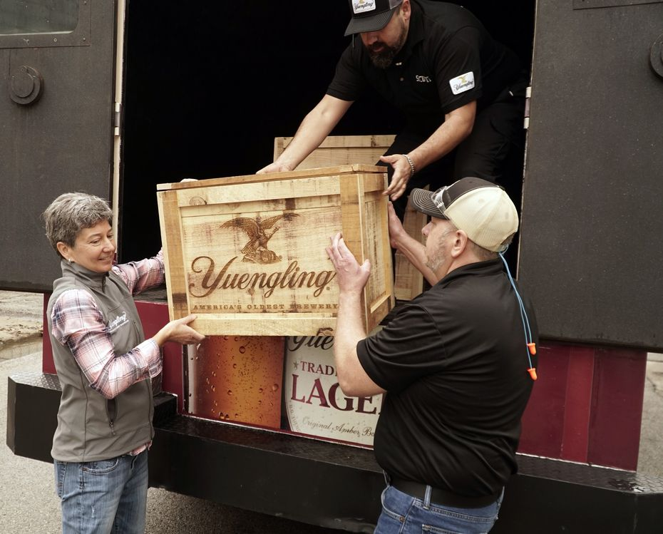 (From left) Jennifer Yuengling, Edgardo Villarroel and Jim Crawford unload crates carrying the Yuengling family recipes to Molson Coors' in Fort Worth on May 11, 2021.