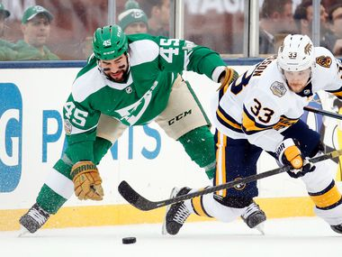 Dallas Stars defenseman Roman Polak (45) battles Nashville Predators right wing Viktor Arvidsson (33) for the puck during the third period of the NHL Winter Classic hockey game at the Cotton Bowl in Dallas, Wednesday, January 1, 2020. The Stars came back to win, 4-2.