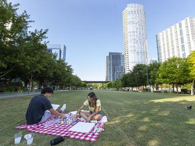 David Velazquez of Dallas paints with his girlfriend, Chloe Alvarez, on Wednesday at Klyde Warren Park near downtown Dallas.