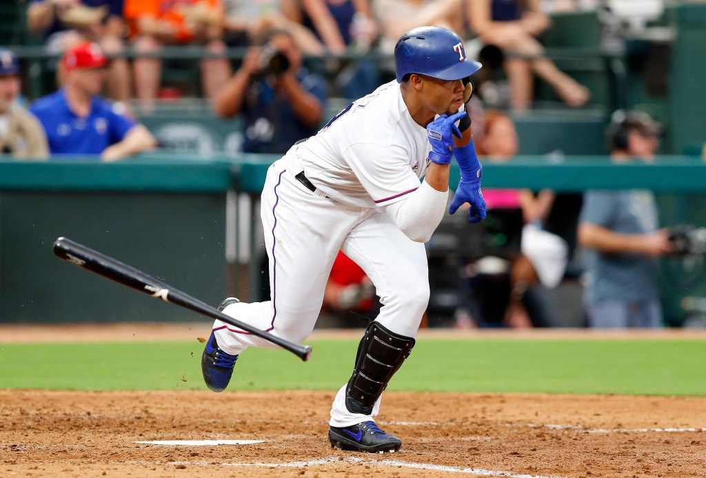 Texas Rangers batter Carlos Gomez (14) flips his bat as he drives in two runs on a single to center in the third inning against the Houston Astros at Globe Life Park in Arlington, Friday, August 11, 2017. (Tom Fox/The Dallas Morning News)