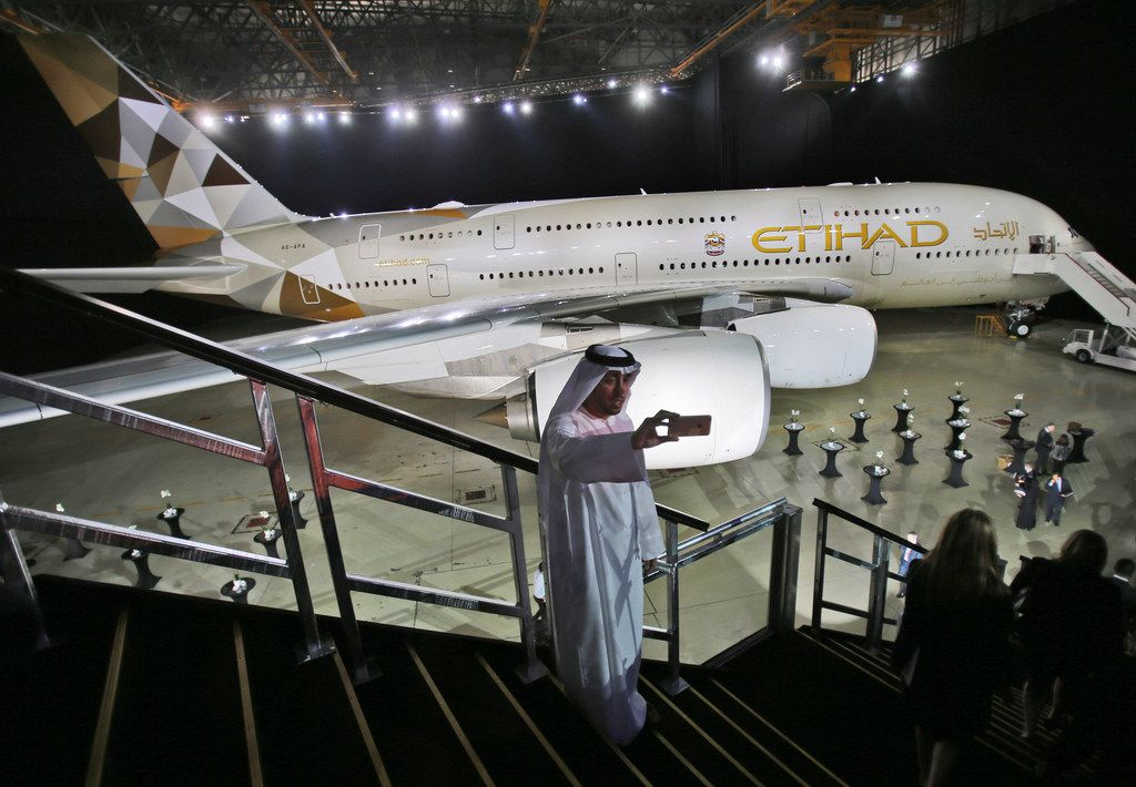 An Emirati man takes a selfie in front of a new Etihad Airways A380 in Abu Dhabi, United Arab Emirates.