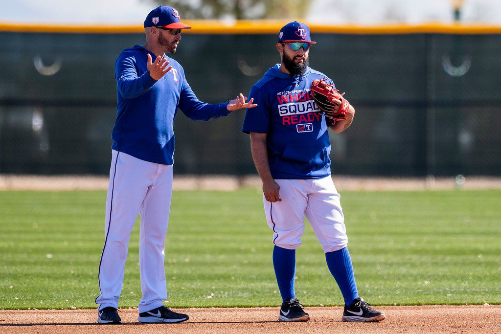 Texas Rangers manager Chris Woodward (left) talks with second baseman Rougned Odor during a spring training workout at the team's training facility on Tuesday, Feb. 19, 2019, in Surprise, Ariz.. (Smiley N. Pool/The Dallas Morning News)
