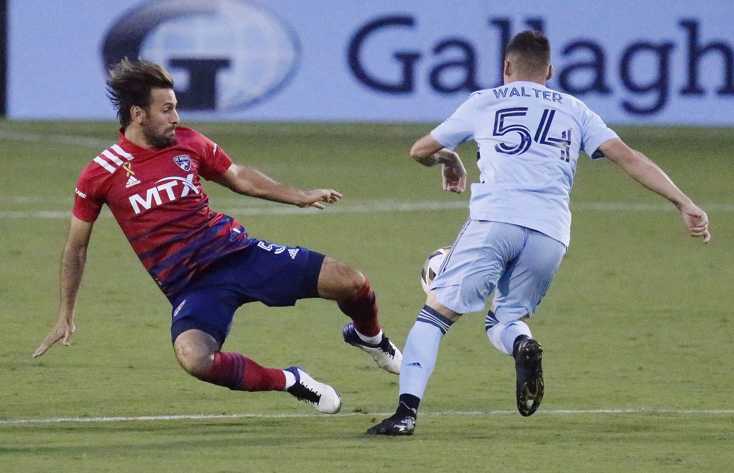 FC Dallas midfielder Facundo Quignon (5) tries to make a play on the ball before Sporting Kansas City midfielder Remi Walter (54) during the first half as FC Dallas hosted Sporting Kansas City at Toyota Stadium in Frisco on Wednesday, September 29, 2021. (Stewart F. House/Special Contributor)