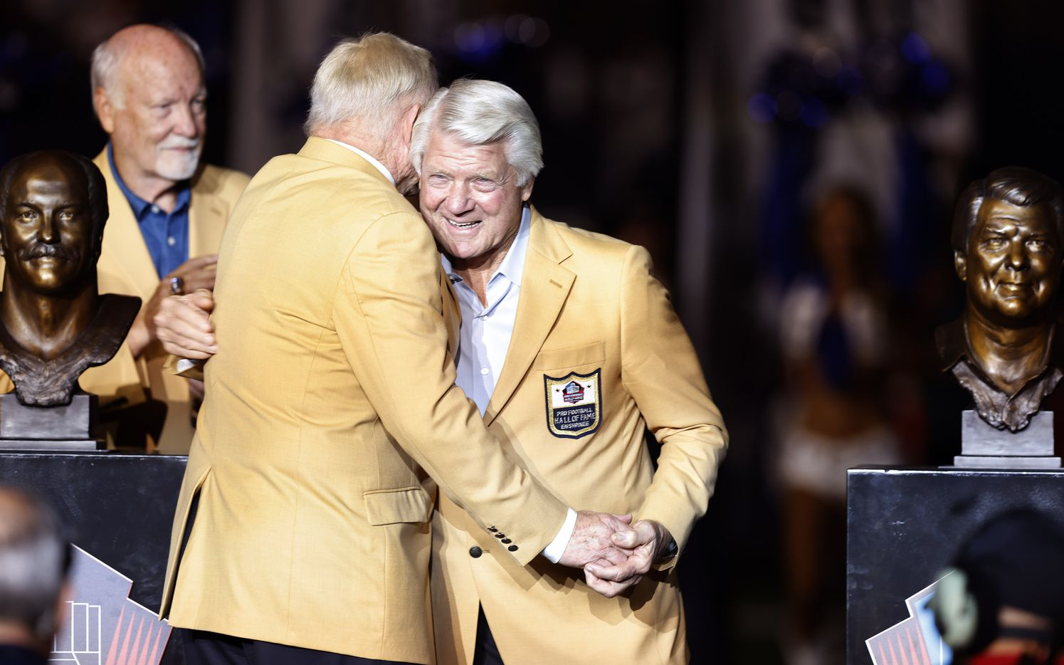 Dallas Cowboys owner Jerry Jones (left) hugs fellow Cowboys Pro Football Hall of Famer Jimmy Johnson during the Hall ring ceremony at AT&T Stadium in Arlington, Monday, September 27, 2021. Jones gave his former coach his Hall of Fame ring.  (Tom Fox/The Dallas Morning News)