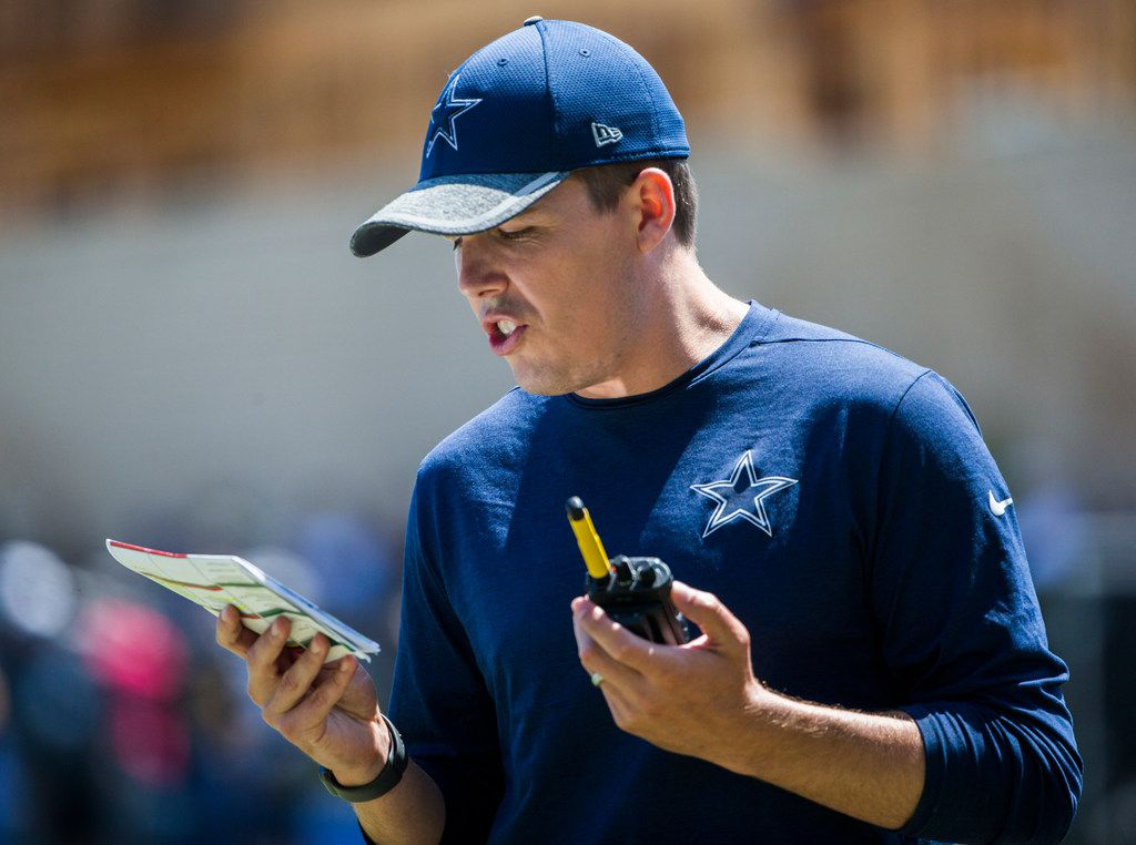 Dallas Cowboys offensive coordinator Kellen Moore calls a play during a morning practice at training camp in Oxnard, California on Thursday, August 8, 2019. (Ashley Landis/The Dallas Morning News)