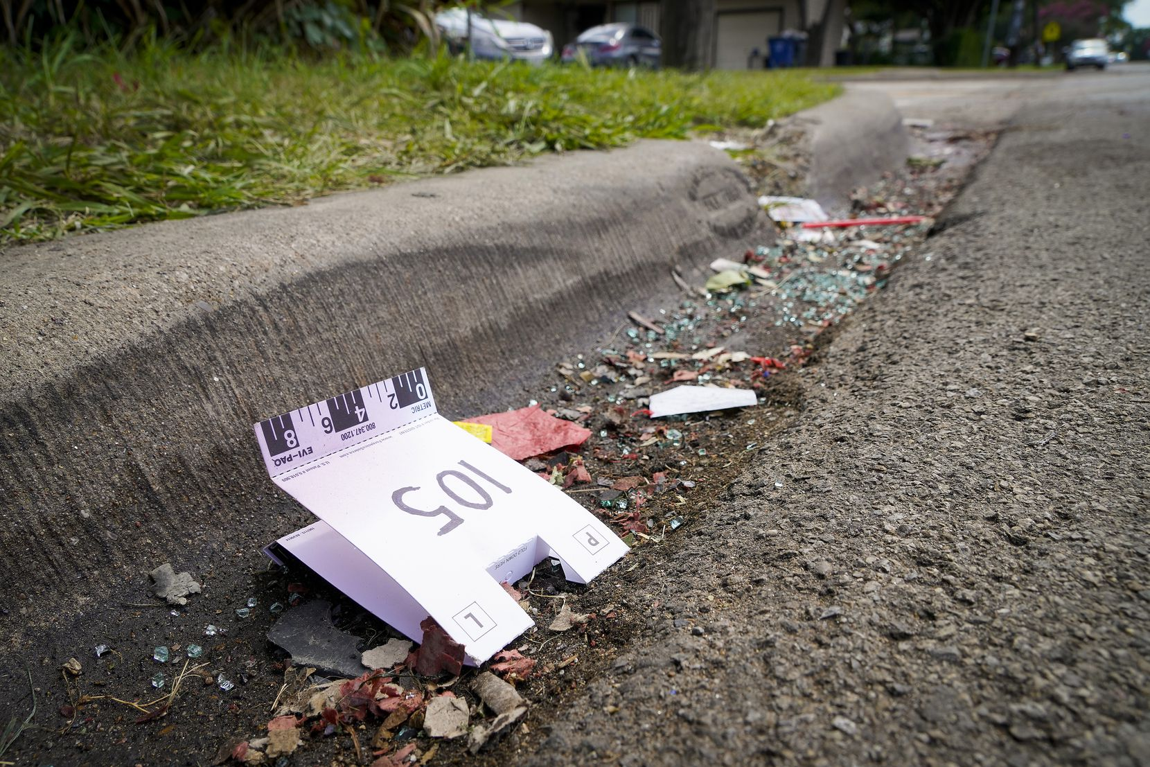 A crime scene evidence tent rests in the gutter near the scene of a shooting in the 8300 block of Towns Street in Hamilton Park on Monday.
