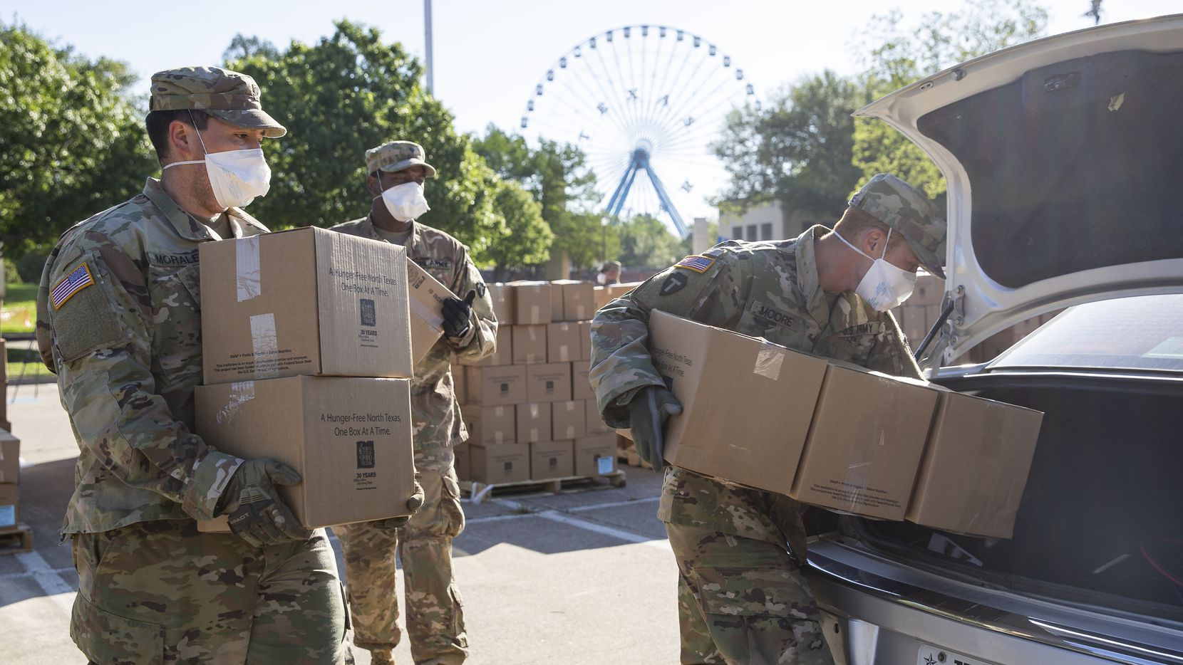 Members of the Texas National Guard help the North Texas Food Bank to distribute free food at Fair Park on April 16, 2020 in Dallas.