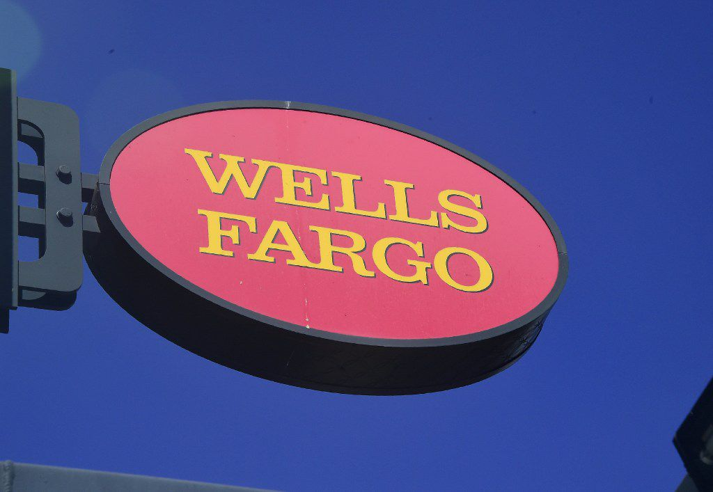 """A Wells Fargo sign is seen in front of a branch in Pasadena, California on September 28, 2016. Wells Fargo CEO John Stumpf will forgo USD 41 million in compensation, the bank's board of directors announced, as punishment for a bogus accounts scandal that has rocked the company. The California Treasurer John Chiang has said the state will suspend several banking relationships with Wells Fargo (WFC) to sanction the firm following allegations of """"fleecing its customers.""""  / AFP PHOTO / Frederic J. BROWNFREDERIC J. BROWN/AFP/Getty Images"""