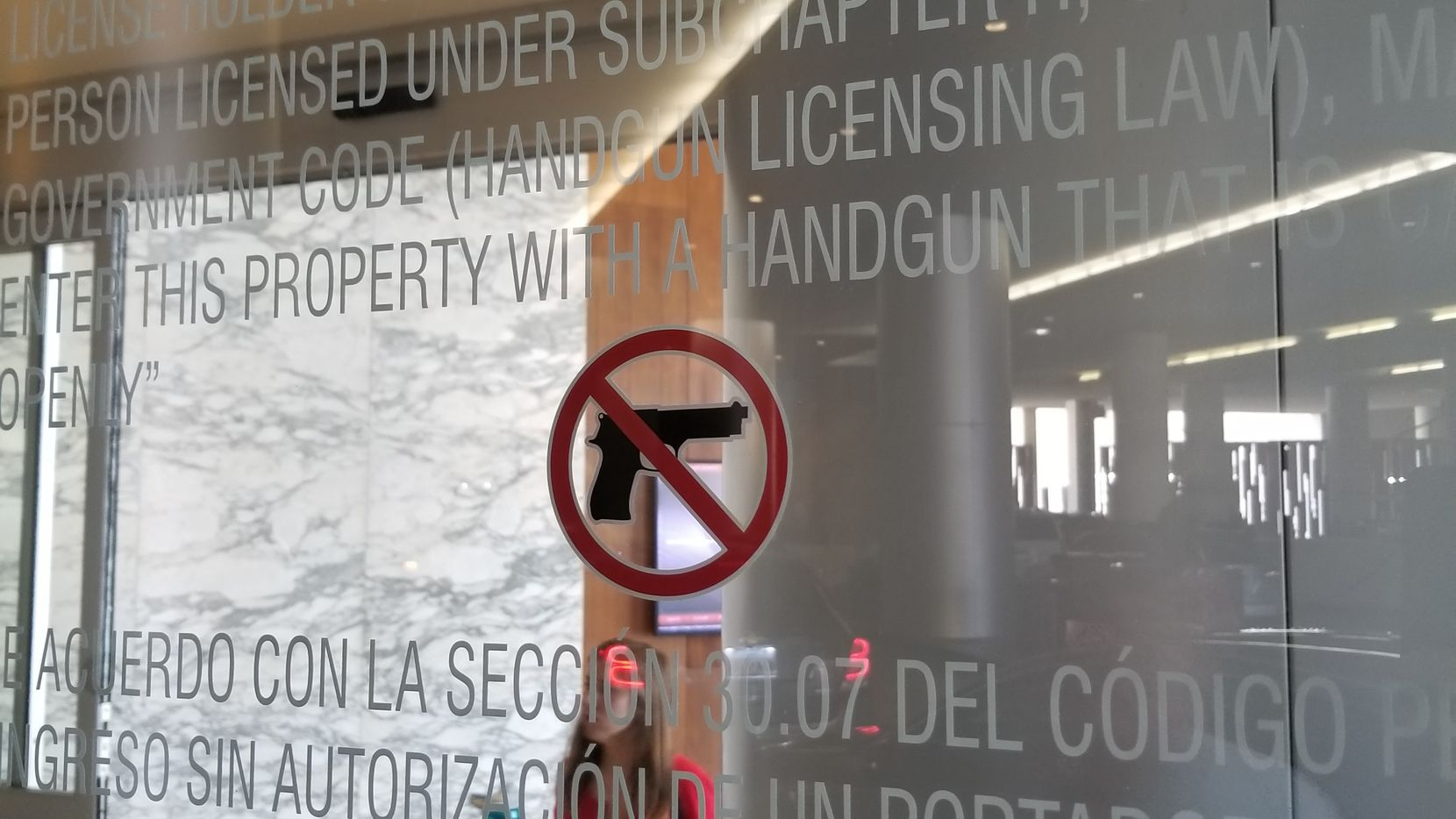 Legal notice at the entrance to the Grand Hyatt in downtown San Antonio, next to the Henry B. Gonzalez Convention Center, where the Texas Republican Party is holding its 2018 convention. Some delegates were miffed that they can't carry firearms openly or with a concealed carry permit at the headquarters hotel.
