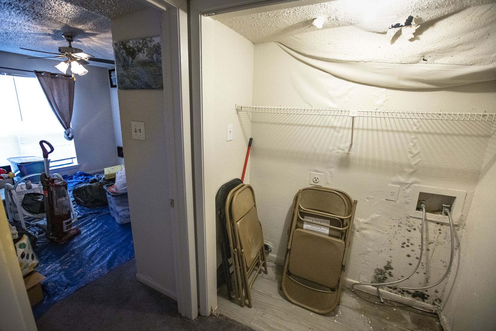 The ceiling droops, water pools on the floor, and mold grows on the walls in the bedroom and laundry room of Maria Magarin's apartment. Magarin's apartment sustained extensive water damage and lost hot water due to the epic snowstorm that hit a few weeks ago. By Friday, she was moving out.