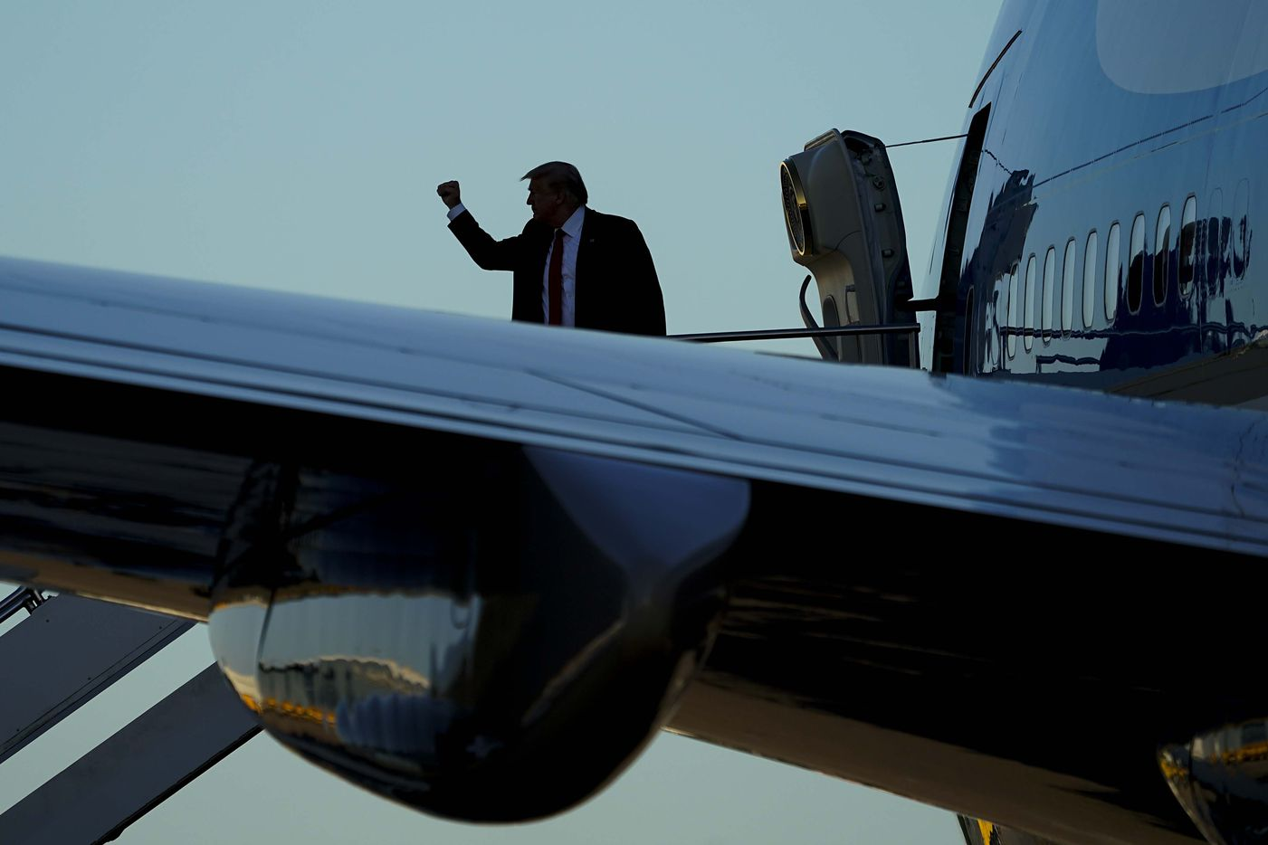 President Donald Trump board Air Force One prior to departing Dallas Love Field Airport after he participated in a roundtable conversation about race relations and policing, and attended a fundraiser at a private residence, on Thursday, June 11, 2020, in Dallas. (Smiley N. Pool/The Dallas Morning News)