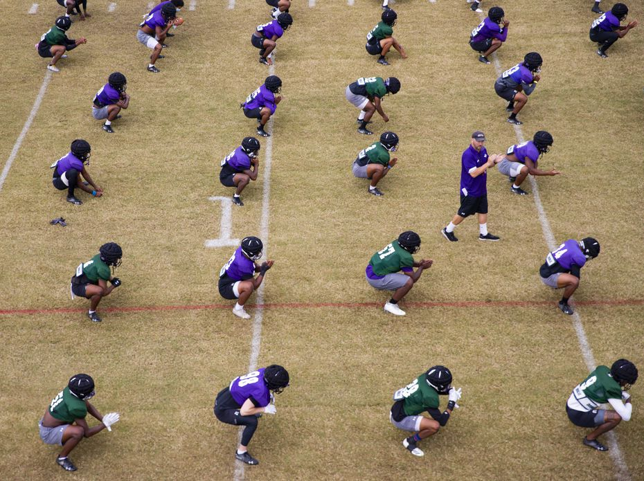Stephen F. Austin Lumberjacks stretch as coach Colby Carthel leads them during practice in Nacogdoches on Thursday, Oct. 8, 2020 . (Juan Figueroa/ The Dallas Morning News)