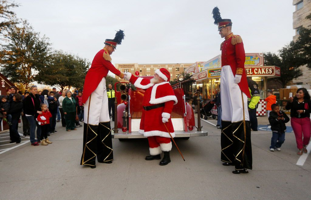 Santa thanks his escorts after he arrived on a vintage fire truck at the Merry Main Street event in Frisco.
