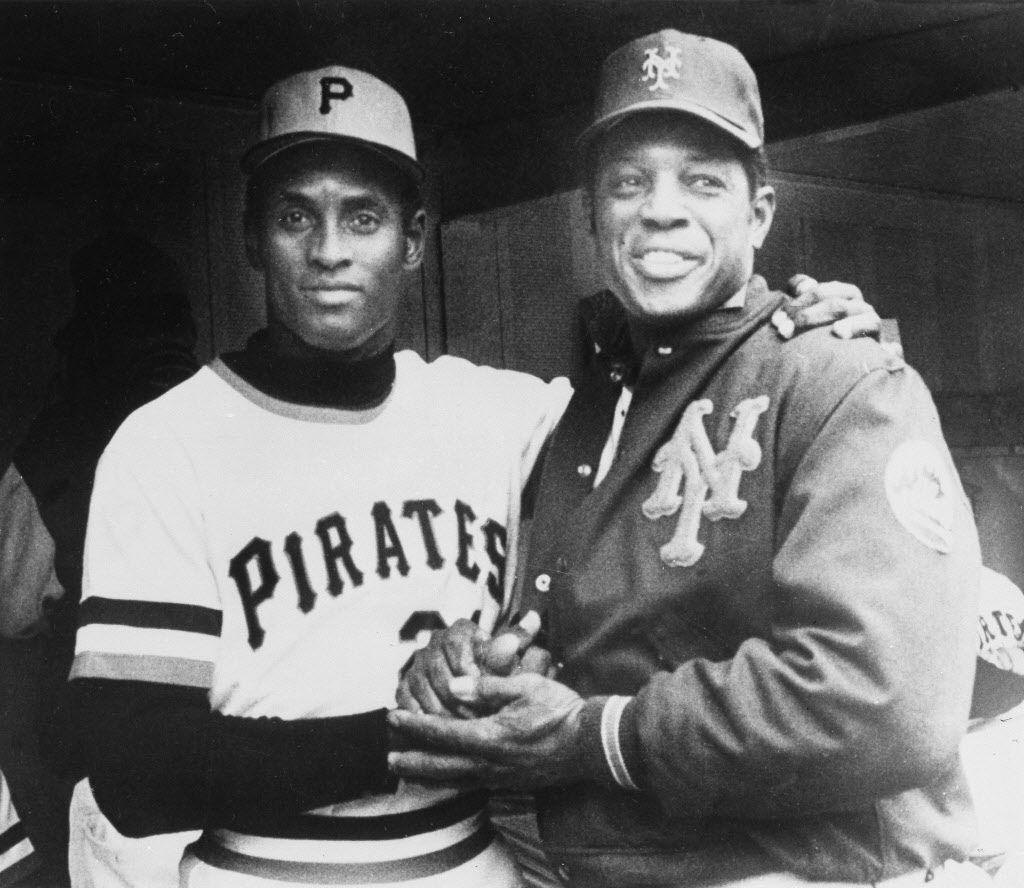 Pirates right fielder Roberto Clemente, left, gets a hand from Mets' Willie Mays after he belted his 3,000th hit in Pittsburgh, Sept. 30, 1972. Clemente, by doing so, became on e of 11 players in the history of the majors to hit that number or better. Mays is also a member of the 3,000 or better club. Pirates won the game, 5-0. (AP Photo/MB)