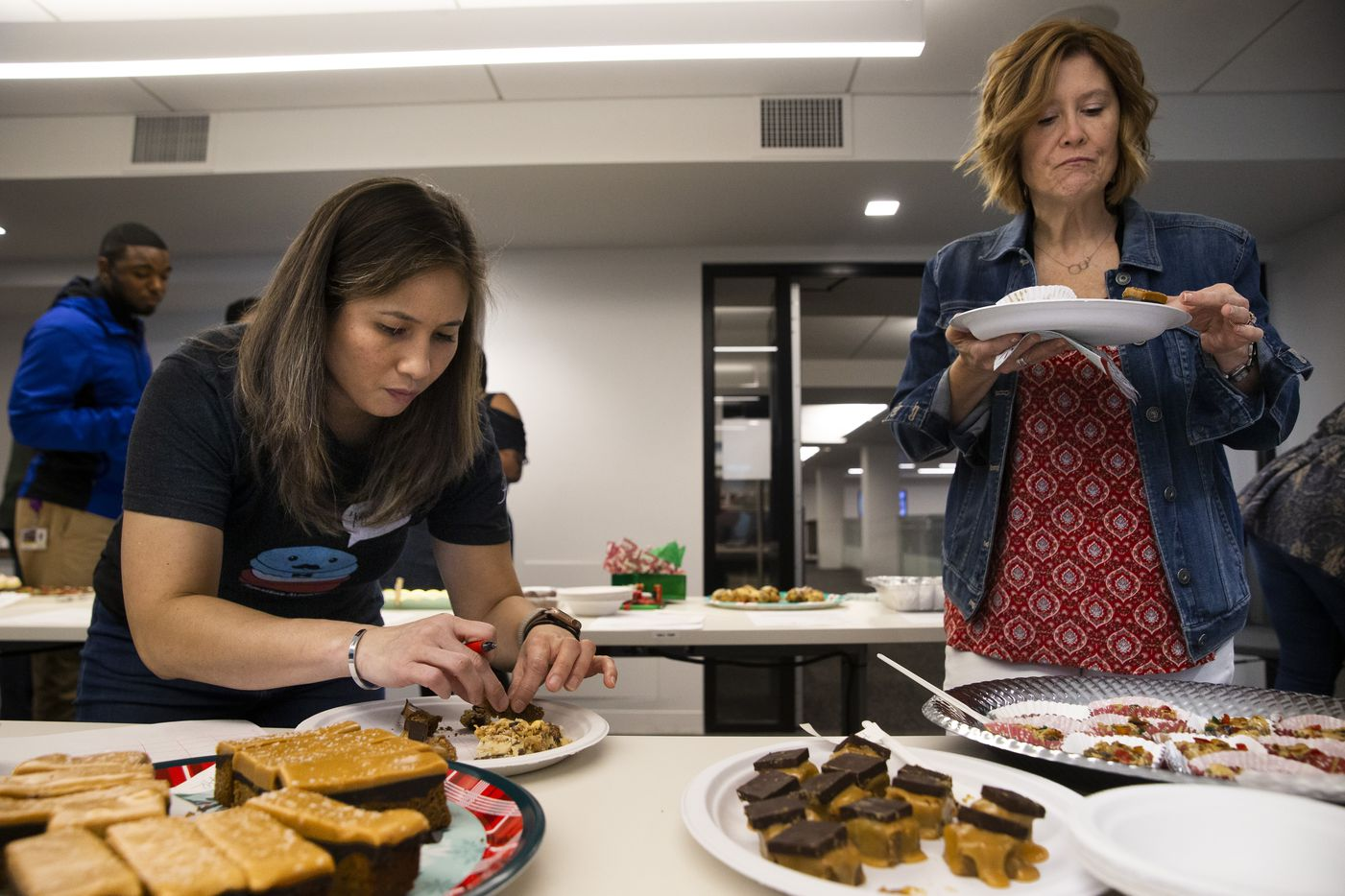 Judge Tida Pichakron of Haute Sweet Patisserie and reader judge Kelly Raaum taste cookies during the 24th annual Holiday Cookie Contest hosted by The Dallas Morning News.