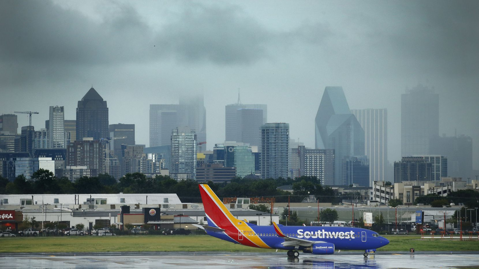 Strong storms associated with a cold front train over downtown Dallas as a Southwest Airlines 737 bound for San Antonio waits to take off from Dallas Love Field, Wednesday, September 9, 2020.(Tom Fox/The Dallas Morning News)