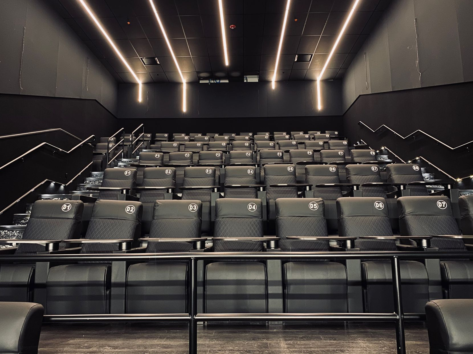 The interior of one of the new theaters that's part of the Studio Movie Grill Chisholm Trail complex in Fort Worth.