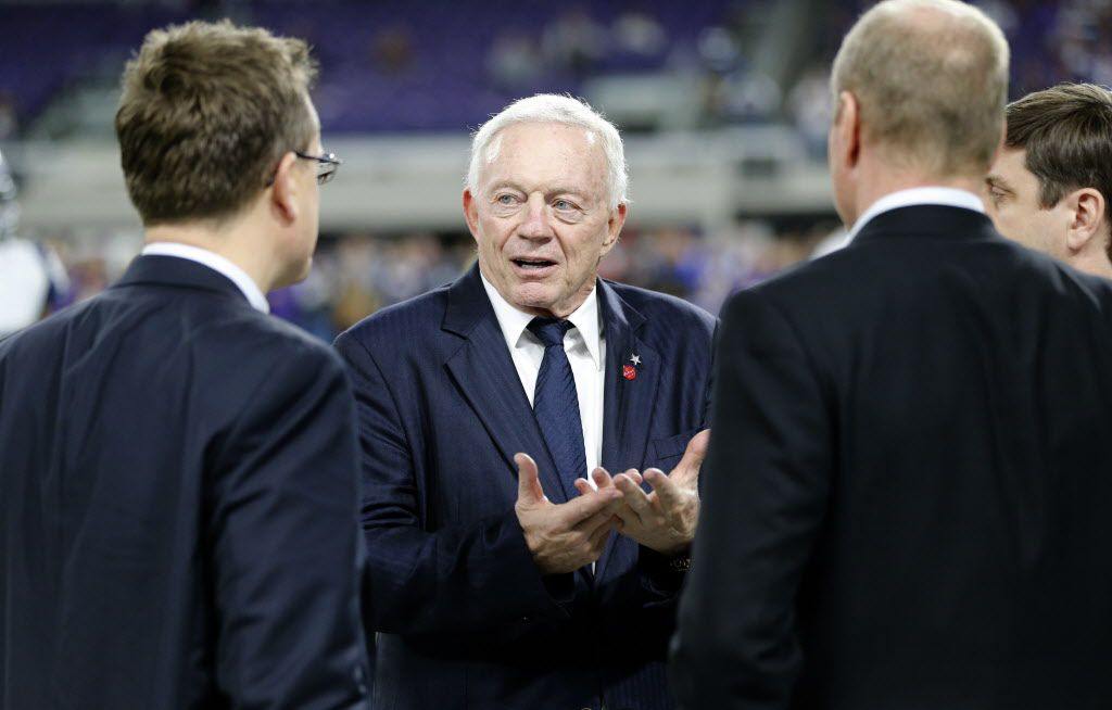 Dallas Cowboys owner Jerry Jones, center, stands on the field before an NFL football game against Minnesota Vikings Thursday, Dec. 1, 2016, in Minneapolis. (AP Photo/Jim Mone)