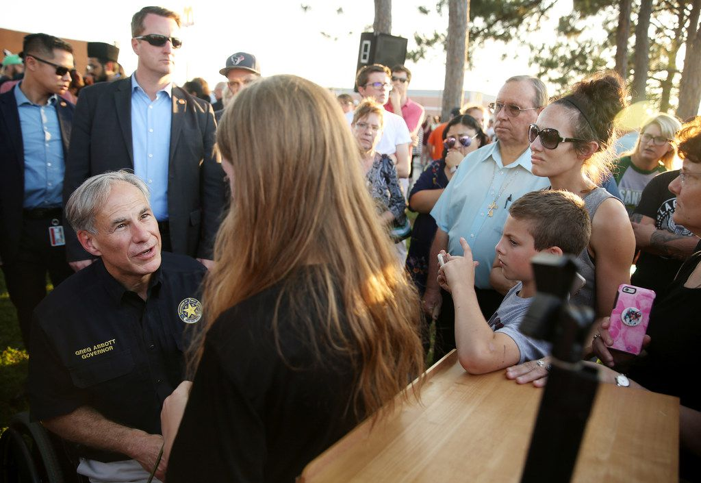 Texas governor Greg Abbott spoke with a student during a vigil after a shooting at Santa Fe High School in Santa Fe, Texas, on Friday. Nine students and a substitute teacher were killed and 10 others injured.
