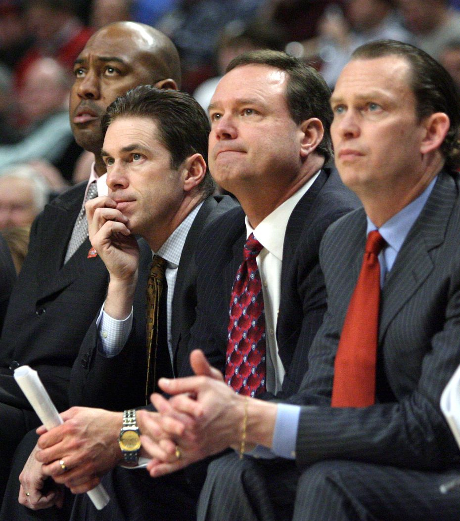 Tim Jankovich (second from left) is pictured with Kansas coach Bill Self (second from right) in the early 2000s. (Courtesy of Kansas Athletics)