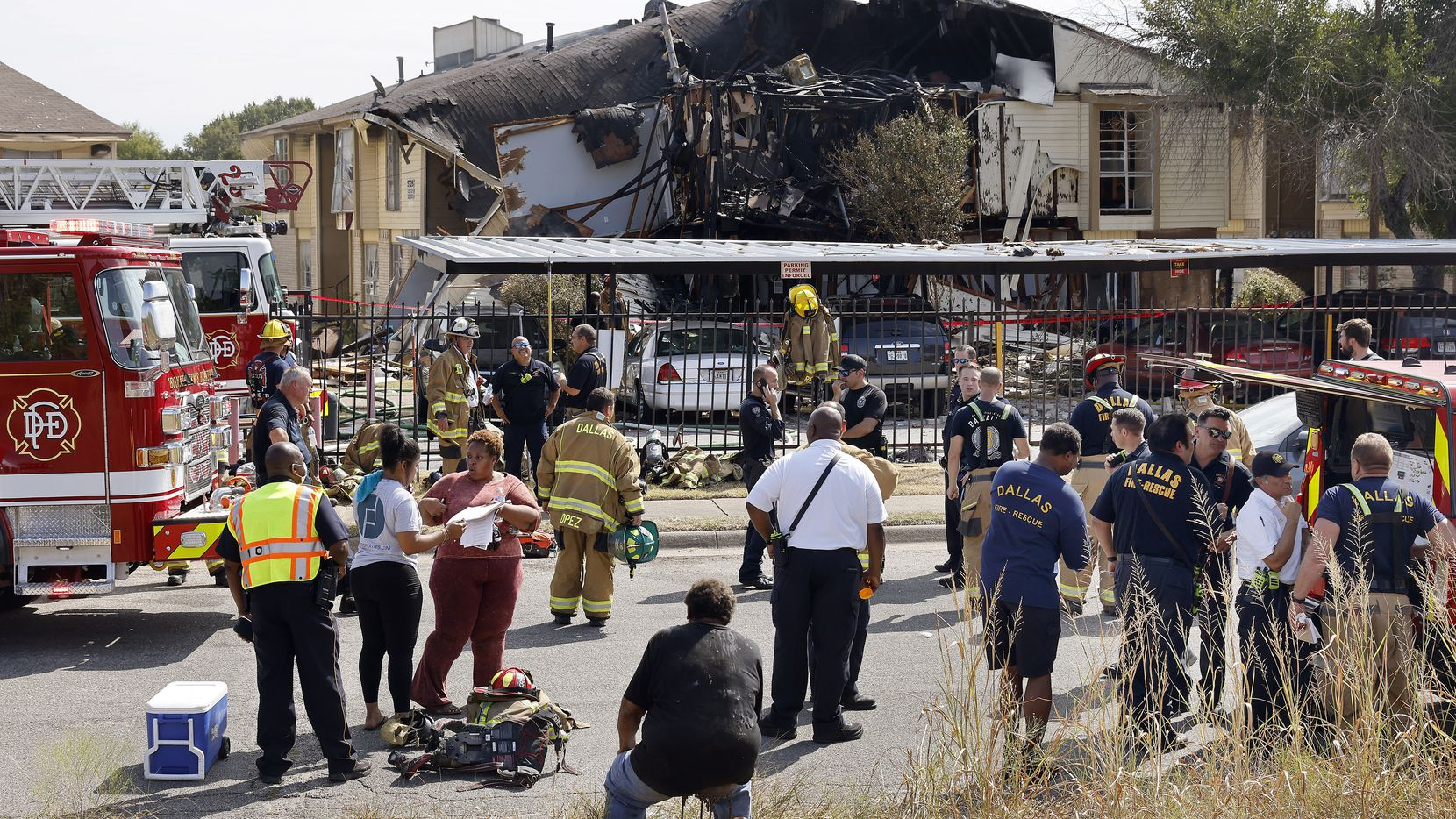 Dallas Fire-Rescue works the scene of an apartment explosion in the 5700 block of Highland Hills Drive in southeast Oak Cliff on Wednesday.