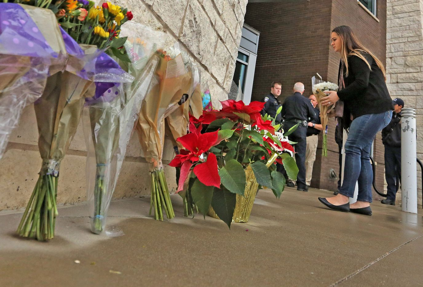 Residents place flowers outside the Little Elm Police Department on Wednesday. (Louis DeLuca/Staff Photographer)