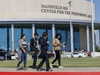 From left, Veronica Garza walks with her children Jose Gonzalez, 15, Natalie Gonzalez, 16, and Deserae Gonzalez, 19, outside of the Mansfield ISD Center for the Performing Arts on Wednesday, Oct. 6, 2021 in Mansfield, Texas. Four people were injured in a shooting at Timberview High School in Arlington on Wednesday morning.