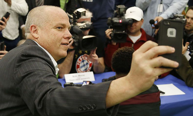 Steve Payne, who resigned as Allen High School principal in October, takes a selfie as Kyler Murray is interviewed following Allen's National signing day event in February 2015. Records show that Payne was under investigation over travel expenses, and his resignation was part of an agreement to end the probe.