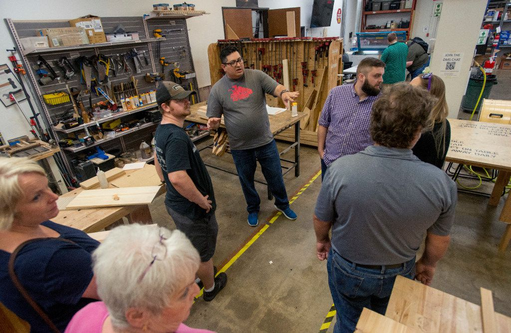 Alex Rhodes, a board member at the Dallas Makerspace, gives a tour of the woodworking area during an open house on June 1, 2017 in Carrollton, Texas. (Robert W. Hart/Special Contributor)
