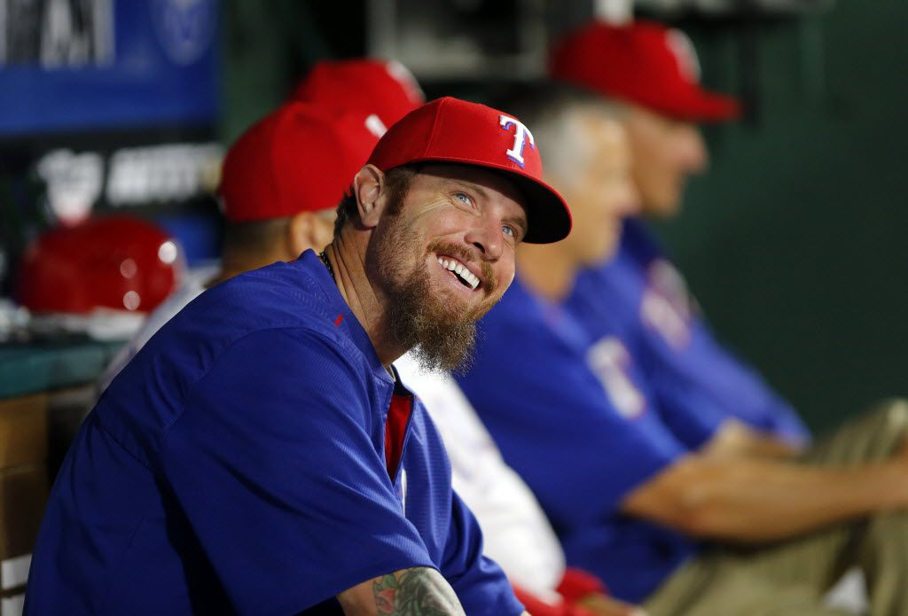 FILE - Texas Rangers Josh Hamilton smiles from the bench while talking to coaches  in the dugout during the eighth inning against the Houston Astros at the Globe Life Park in Arlington, Tuesday, April 19, 2016. (Tom Fox/The Dallas Morning News)