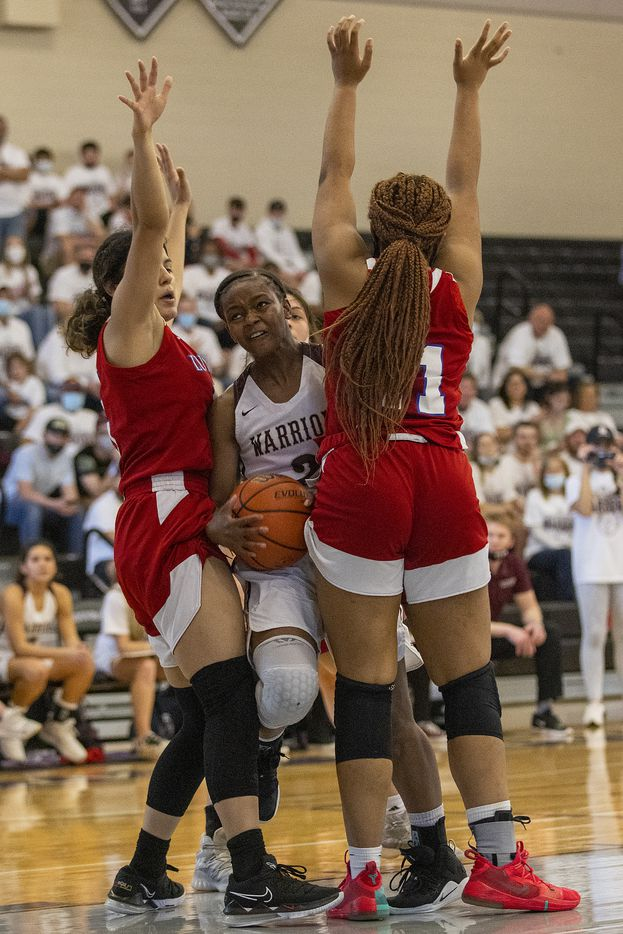 McKinney Cornerstone's Johnai Bennett (2) gets squeezed between Houston Lutheran High North defenders Andrea Ramirez, left, and Kaitlin Alexander (11) during the TAPPS 3A girls championship at College Station High School on Saturday, March 13, 2021. McKinney Cornerstone lost, 62-34. Michael Miller/Special Contributor