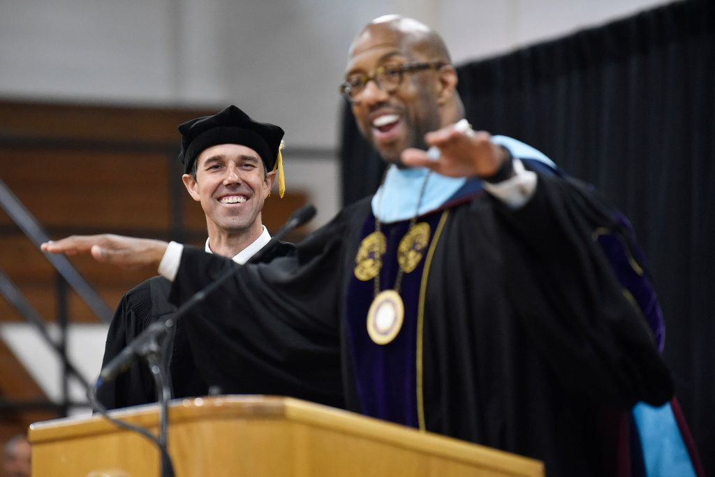 Presidential candidate Beto O'Rourke (left) smiles as Paul Quinn College president Michael Sorrell introduces O'Rourke as commencement speaker on Saturday, May 4, 2019.