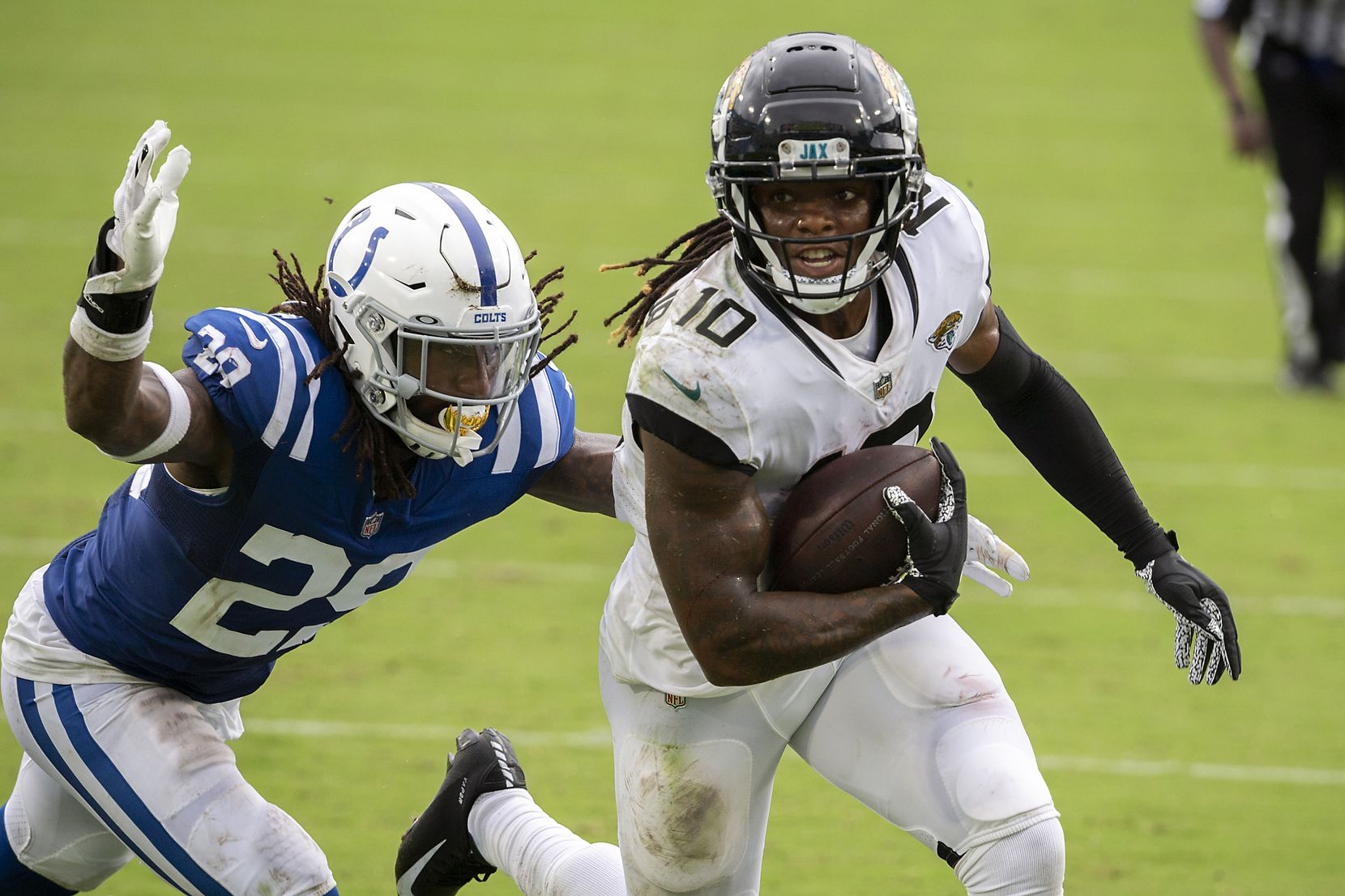 Jacksonville Jaguars wide receiver Laviska Shenault Jr. (10) scores a touchdown in front of Indianapolis Colts free safety Malik Hooker (29) during the first half of an NFL football game, Sunday, Sept. 13, 2020, in Jacksonville, Fla. (AP Photo/Stephen B. Morton)