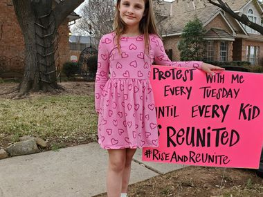 Seven-year-old Paisley Elliott advocates for separated border families each week outside her Grapevine home.
