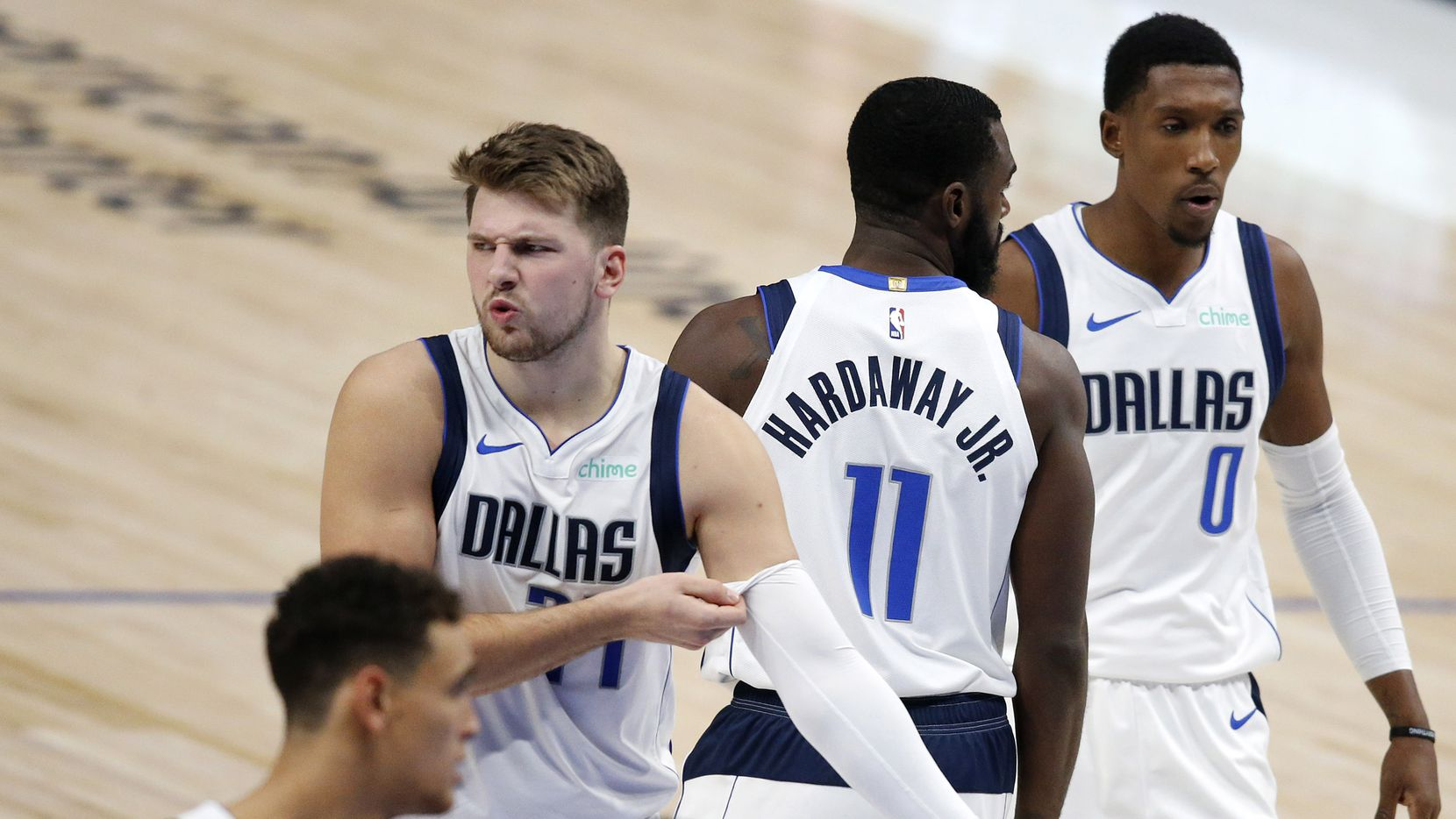 Dallas Mavericks guard Luka Doncic (77) reacts after drawing a call against the Minnesota Timberwolves in the second quarter of a preseason game at the American Airlines Center in Dallas, Thursday, December 17, 2020.
