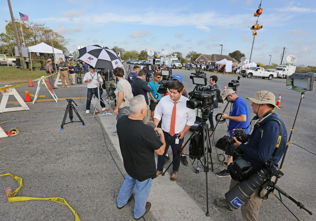 Sutherland Springs resident David Casillas talks with the media at the intersection near the First Baptist Church of Sutherland Springs, Texas. At least 26 people died Sunday after a gunman opened fire at a Baptist church in the small town southeast of San Antonio. Photographed on Monday, November 6, 2017. (Louis DeLuca/The Dallas Morning News)