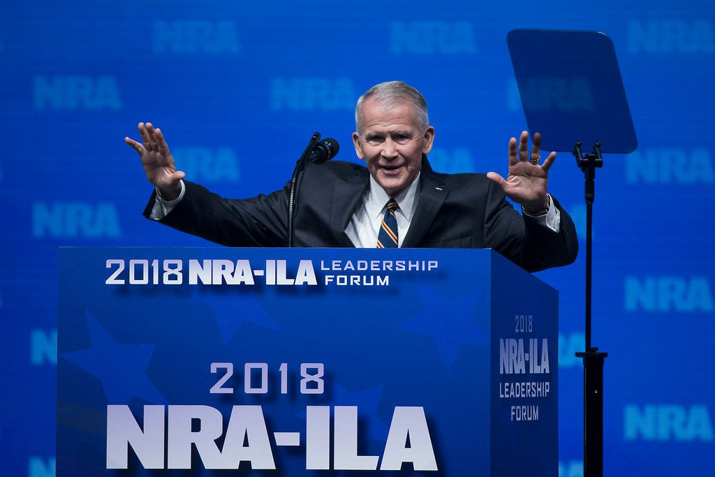 Oliver North quiets the crowd to lead the invocation addresses the NRA-ILA Leadership Forum at the Kay Bailey Hutchison Convention Center on Friday, May 4, 2018, in Dallas.