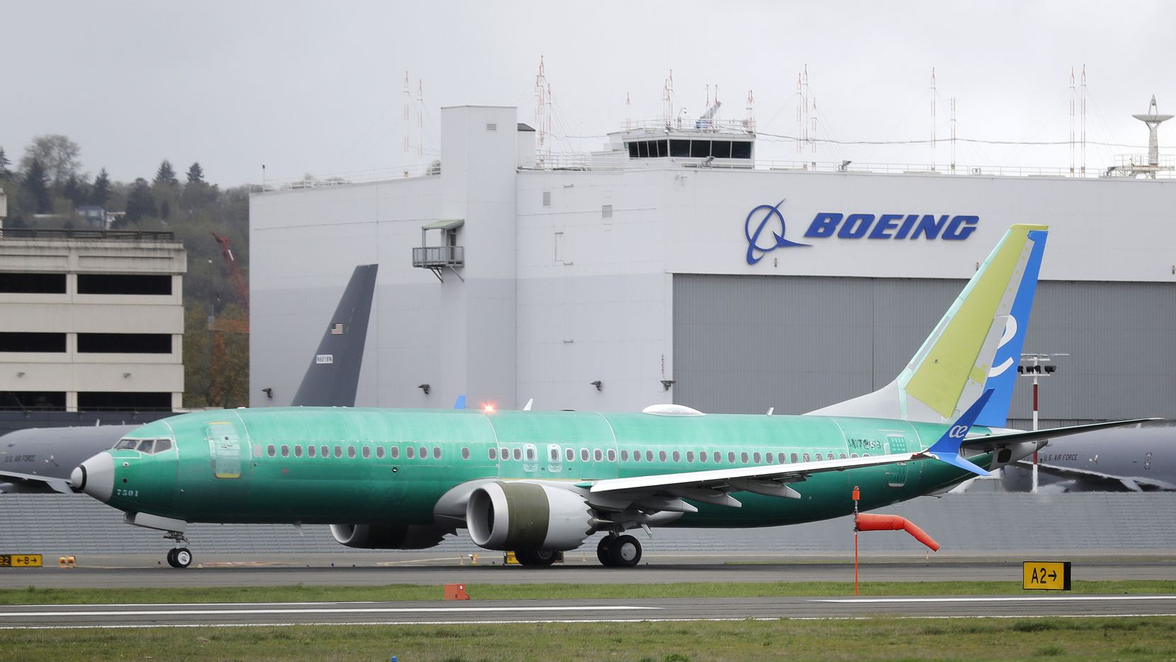 FILE - In this April 10, 2019, file photo a Boeing 737 MAX 8 airplane rolls toward takeoff before a test flight at Boeing Field in Seattle. A Chicago law firm says it has settled lawsuits against Boeing on behalf of the families of 11 passengers killed in the crash of a Lion Air jet off the coast of Indonesia. (AP Photo/Ted S. Warren, File)