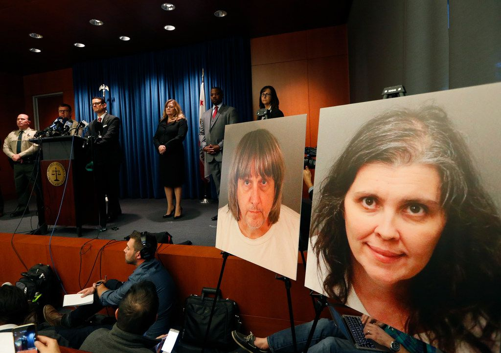 Riverside County District Attorney Mike Hestrin, at podium, takes questions from the media at a news conference regarding the couple accused of starving and torturing their 13 children in Riverside, Calif., Thursday, Jan. 18, 2018.  Authorities say David and Louise Turpin could face charges including torture and child endangerment.  (AP Photo/Damian Dovarganes)
