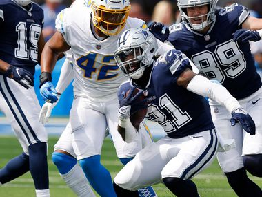 Dallas Cowboys running back Ezekiel Elliott (21) makes a move on the Los Angeles Chargers defense during the first half at SoFi Stadium in Inglewood, California, Sunday, September 19, 2021.