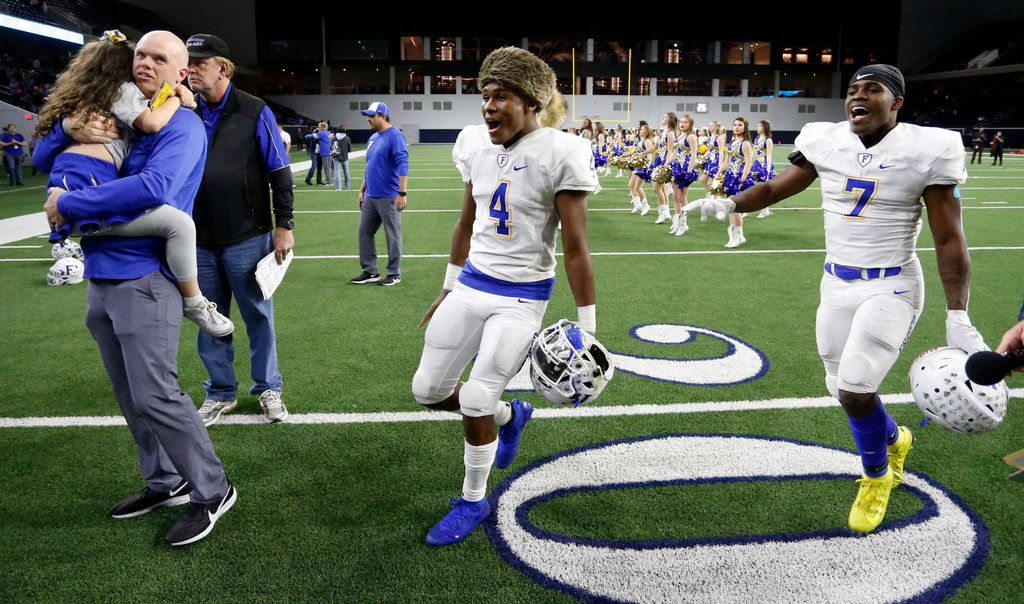 Frisco's Chase Lowery (4), clad in a raccoon skin cap, and Bryson Clemons (7) race around the field in celebration, after their 18-0 win in a high school football playoff game against South Oak Cliff at the Star on Friday, November 22, 2019. Lowery made two interceptions, returning on of them for a touchdown. (John F. Rhodes / Special Contributor)