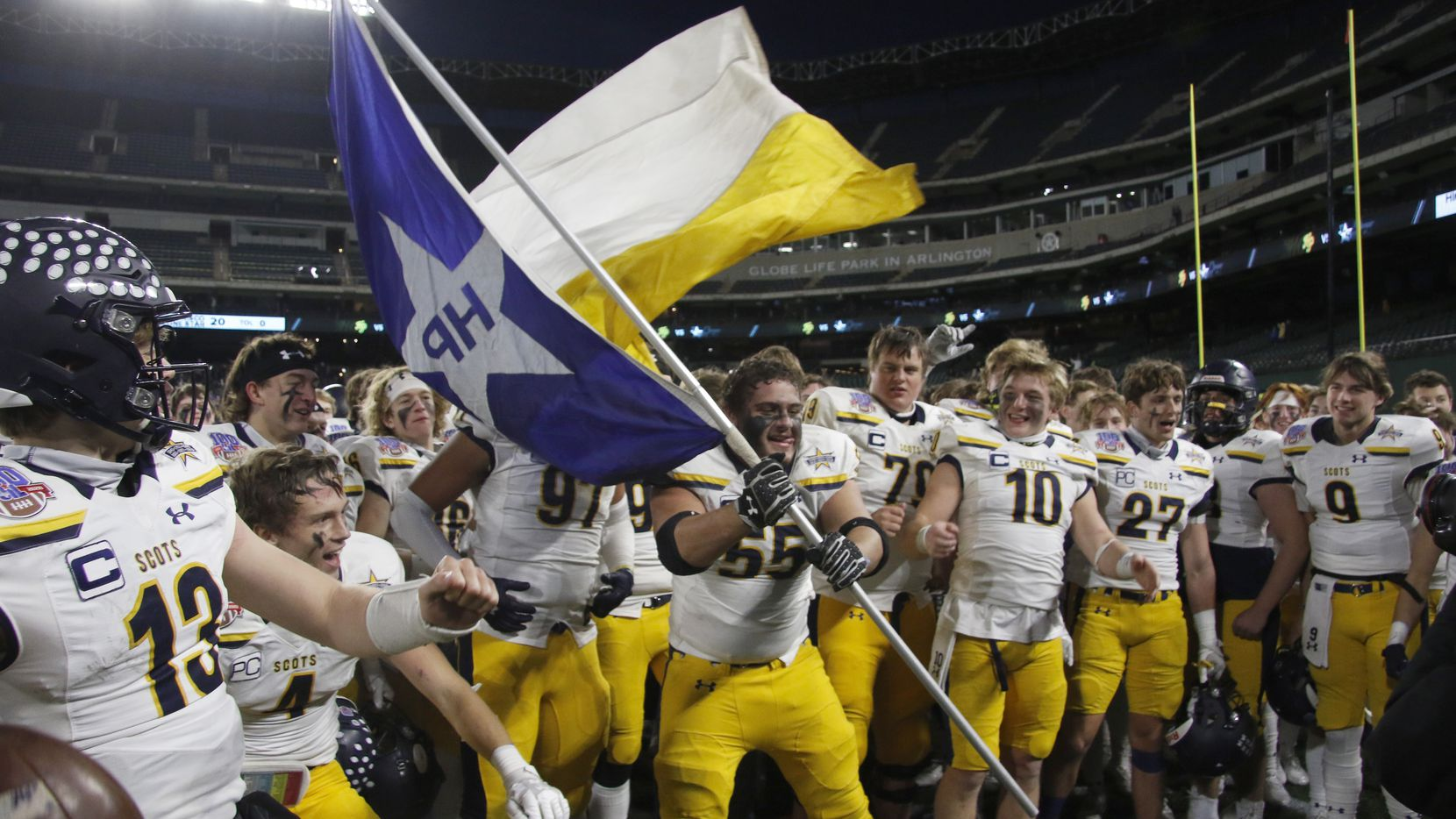 Highland Park offensive lineman Sam Morse (55) handles the flag waving duty as the Scots celebrate following their 30-20 victory over Frisco Lone Star. The two teams played their Class 5A Division l Region ll semifinal football playoff game held at Globe Life Park in Arlington on December 24, 2020.