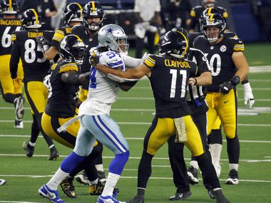 Dallas Cowboys defensive end Randy Gregory (94) and Pittsburgh Steelers wide receiver Chase Claypool (11) tussle after a fourth-quarter play at AT&T Stadium in Arlington, Texas Sunday, November 8, 2020. The Cowboys lost, 24-19.