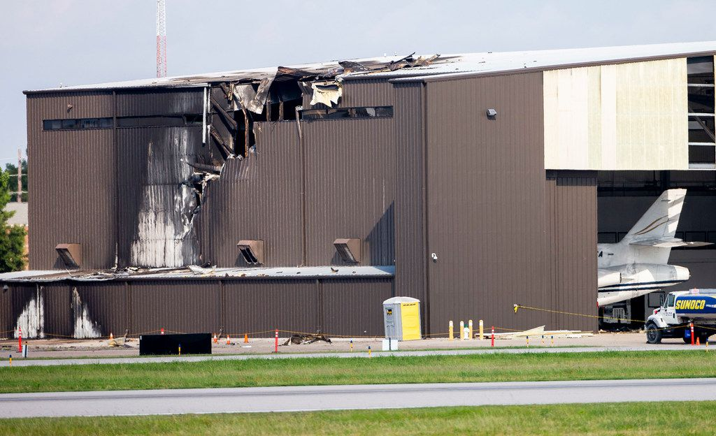 Damage is seen to a hangar after a twin engine plane crashed into the building at Addison Airport in Addison, Texas on Sunday, June 30, 2019. All 10 people aboard a small plane died Sunday morning when it crashed into a hangar on takeoff at Addison Airport, authorities say. The twin-engine Beechcraft BE-350 King Air was destroyed by flames after it crashed at 9:10 a.m., Federal Aviation Administration spokesman Lynn Lunsford said. (Shaban Athuman/Staff Photographer)